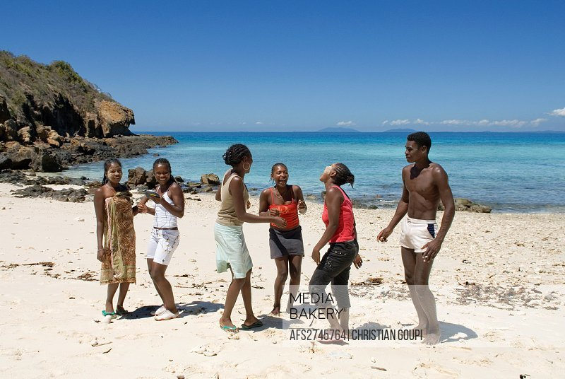 young Malagasy girls dancing on the beach, Tsarabanjina island, Mitsio archipelago, Republic of Madagascar, Indian Ocean