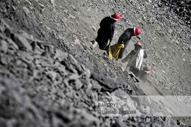 Pallaqueras, female gold miners, pick through the tailings, searching for gold around the gold mines in La Rinconada, Peru, 4 August 2012. During the ...