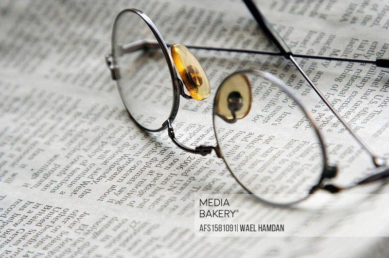 newspaper & eyeglasses