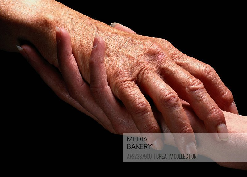 mutual affection between young and old woman, holding hands