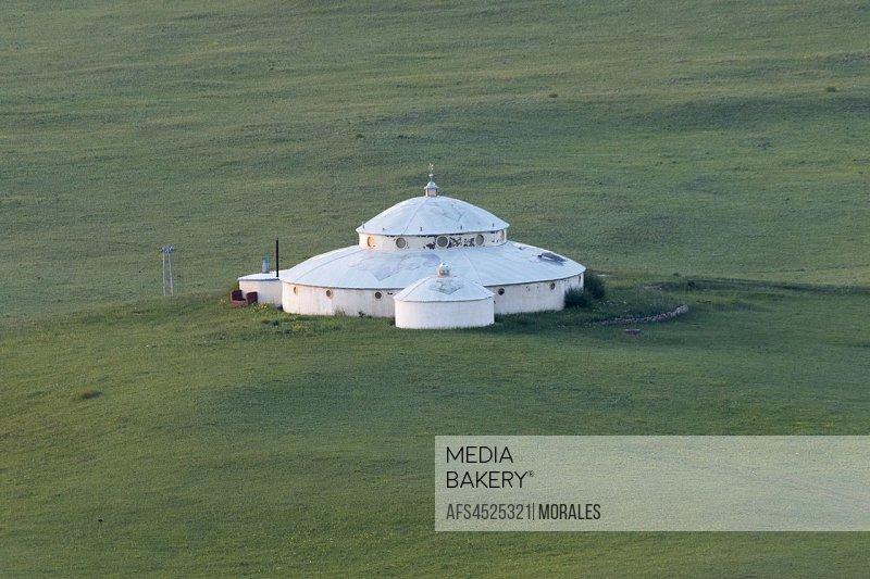 China, Inner Mongolia, Hebei Province, Zhangjiakou, Bashang Grassland, Collinean landscape with a yurt.