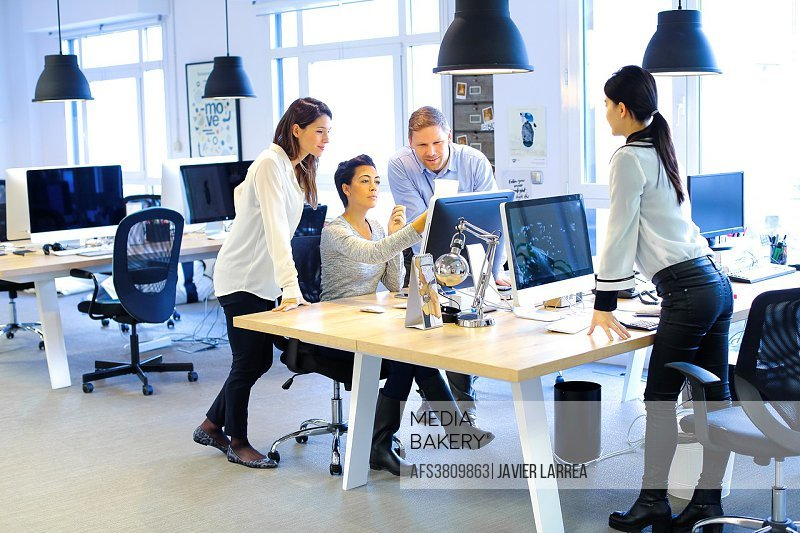 Young executives working in office. Advertising agency.