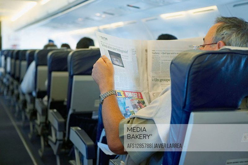 Reading newspaper during flight