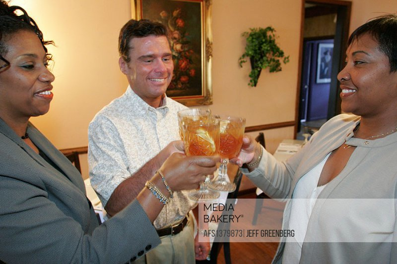 Virginia, Chesapeake, With Flair Tea Room, Black females, White male, iced tea, toasting,