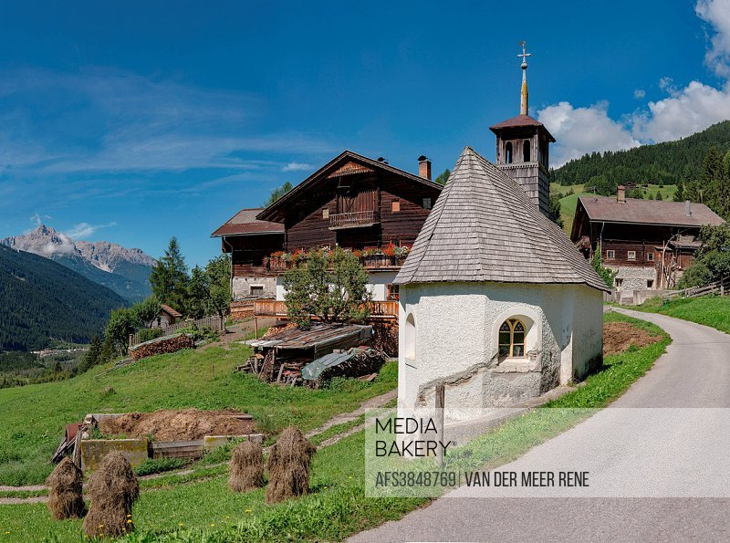 Sillian, Austria, Farmhouse and chapel at mountain Sillianberg