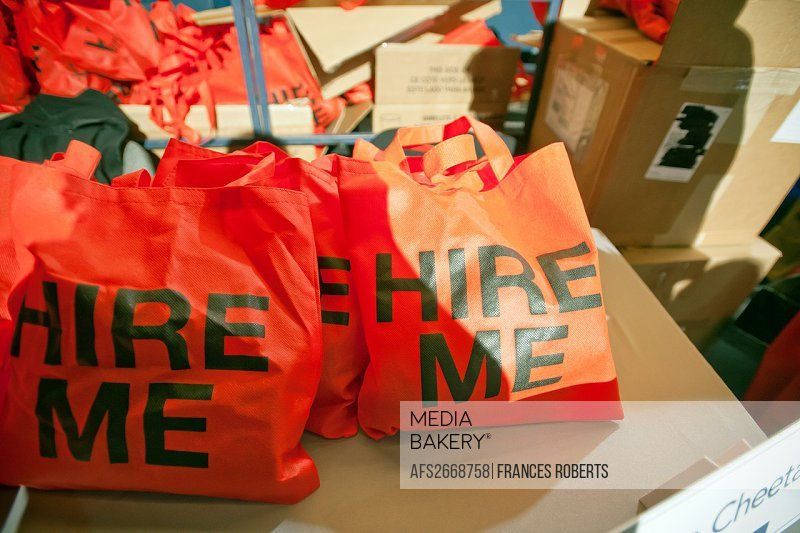 Bags that say Hire Me at a Career Fair at Madison Square Garden in New York