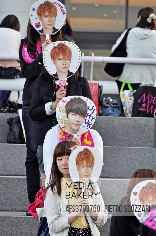 Yokohama, Japan: fans before a concert of a boys-band by the port