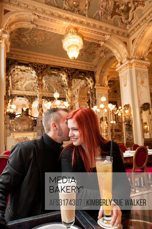 Hungagian couple n in opulent New York Cafe, a 19th century coffee house frequented by writers, Budapest, Hungary, Europe.