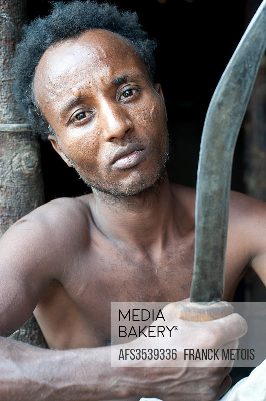 Man belonging to the Kereyu tribe holding his knife ( Ethiopia).