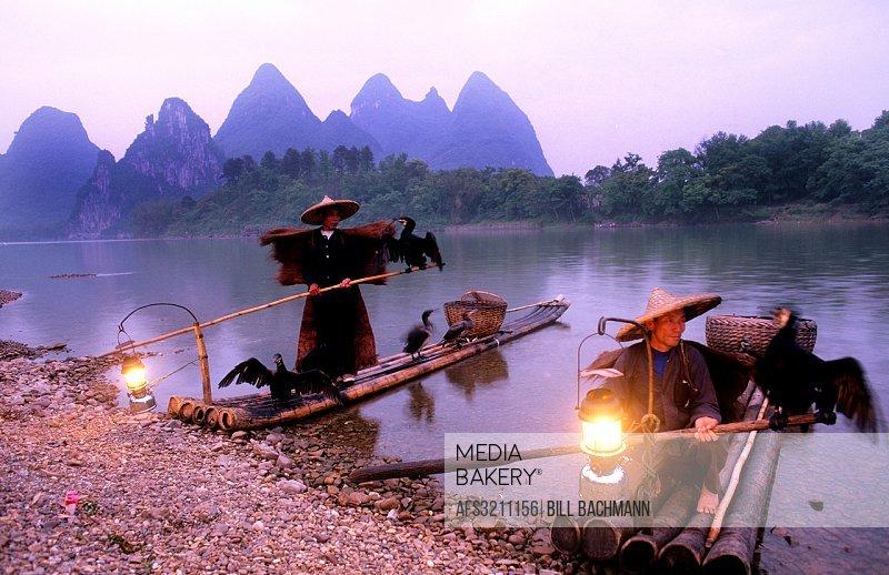 Fishermen Li River with birds Yangshuo China, Guilin Yangshou Li River Fishermen Limestone Mountains.