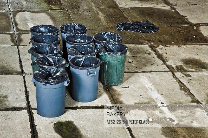 Empty trash barrels with plastic liners