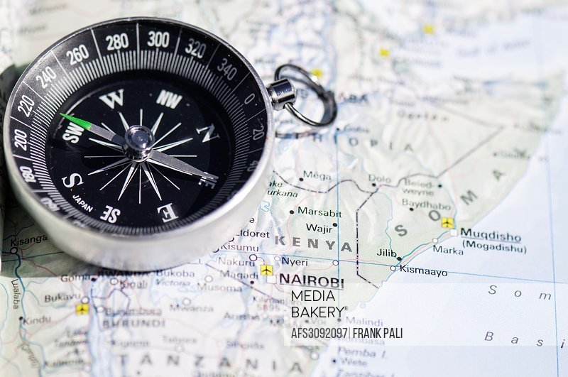 Compass and map of Africa.