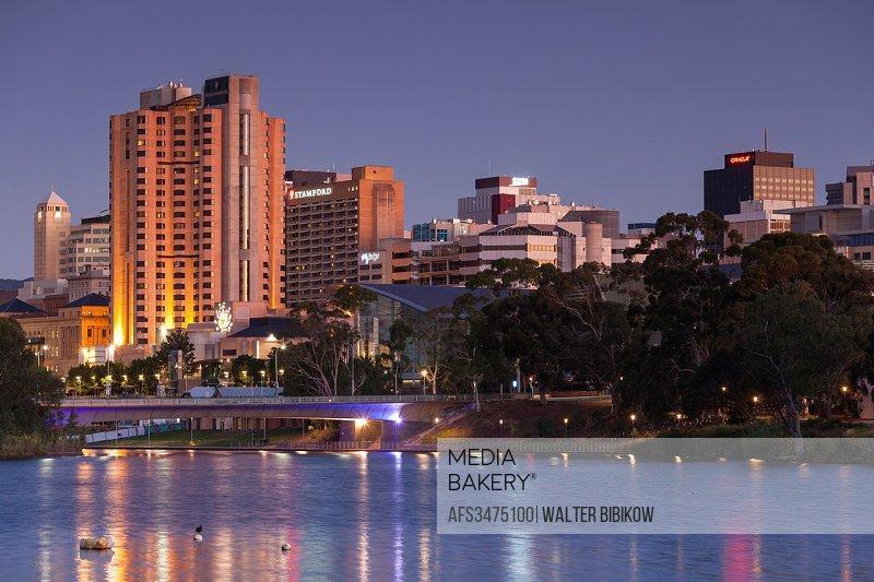 Australia, South Australia, Adelaide, skyline from Torrens Lake, daytime, dusk.