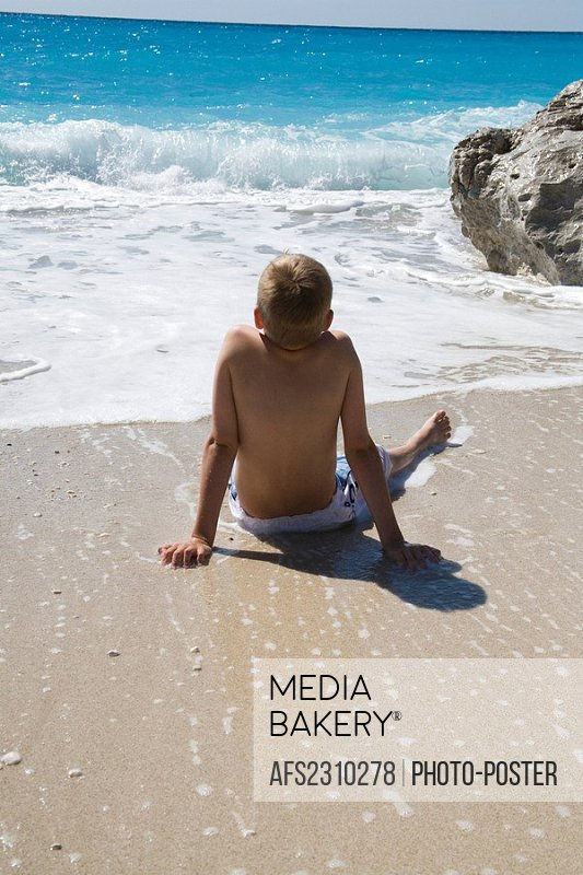 boy relaxes at the beach