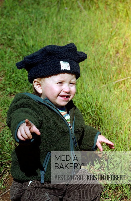 Child pointing happily