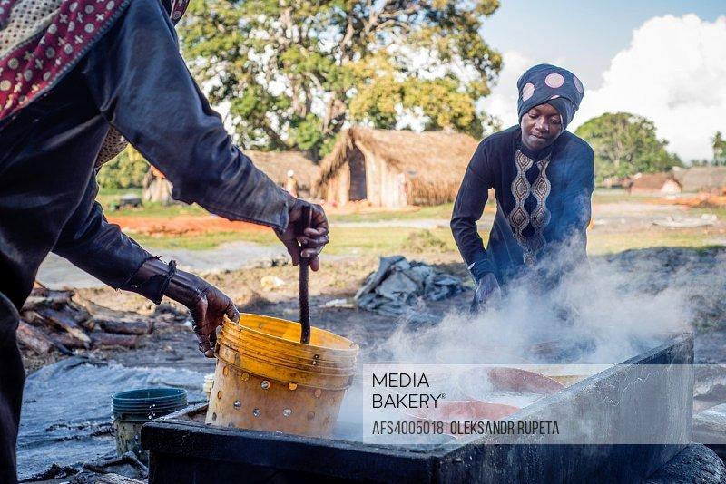 Women prepare anchovies, locally called Dagaa, for drying at Mkokotoni village, Zanzibar. Local people use dagaa for preparing food as itâ. . s much c...