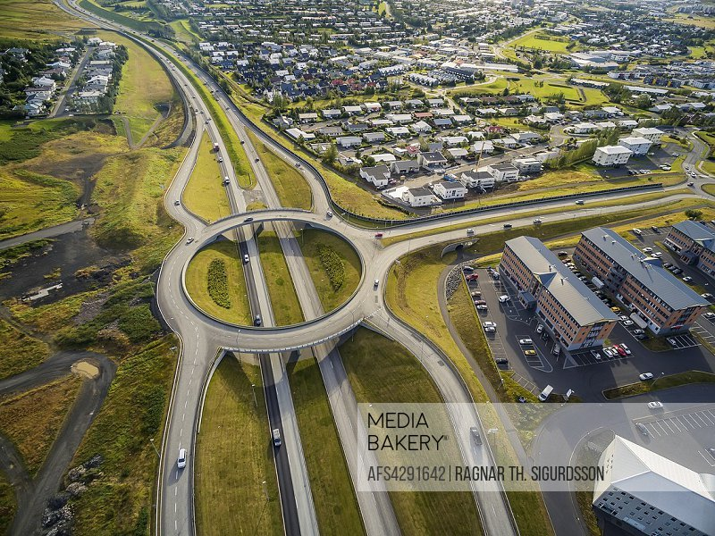 Aerial view of traffic circle and roads, Reykjavik area, Iceland.