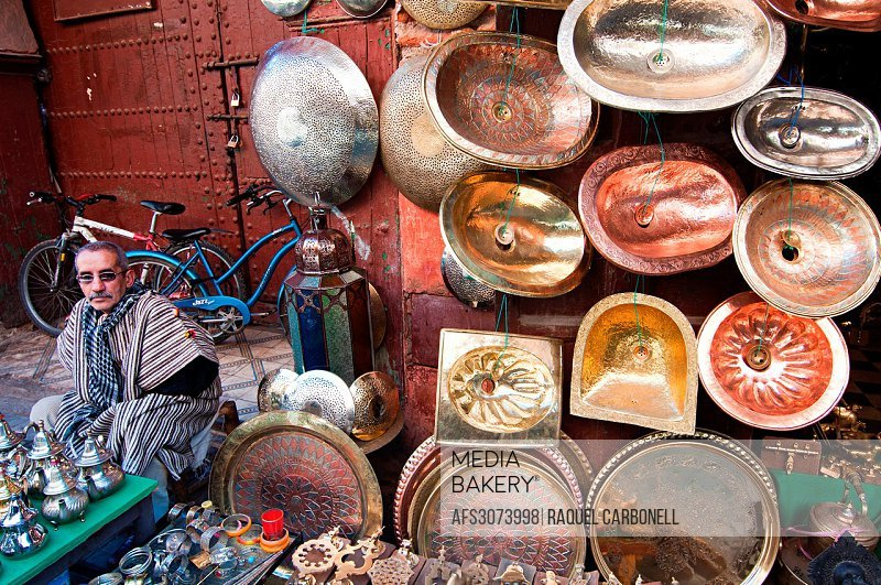 Brass objects in a street stall. Marrakech medina, Morocco.