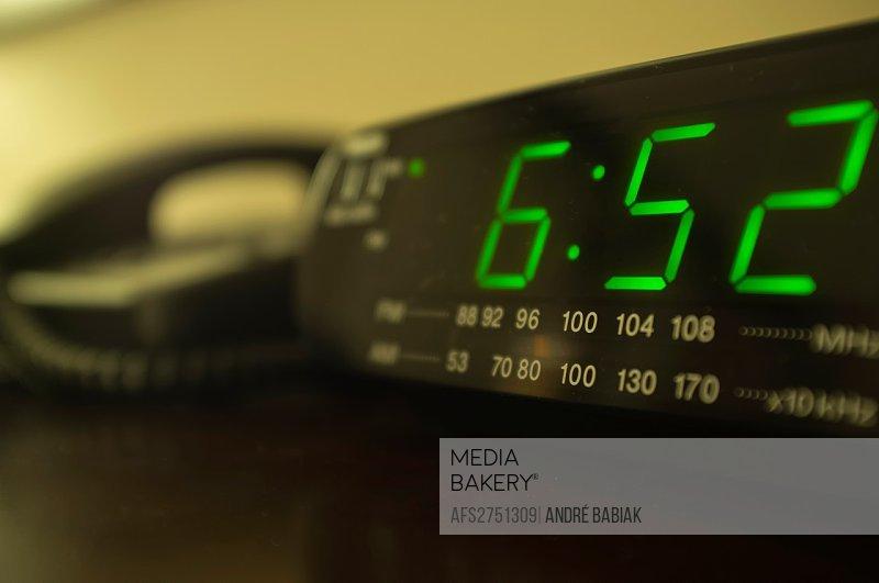 Hotel room nightstand with radio alarm clock and telephone
