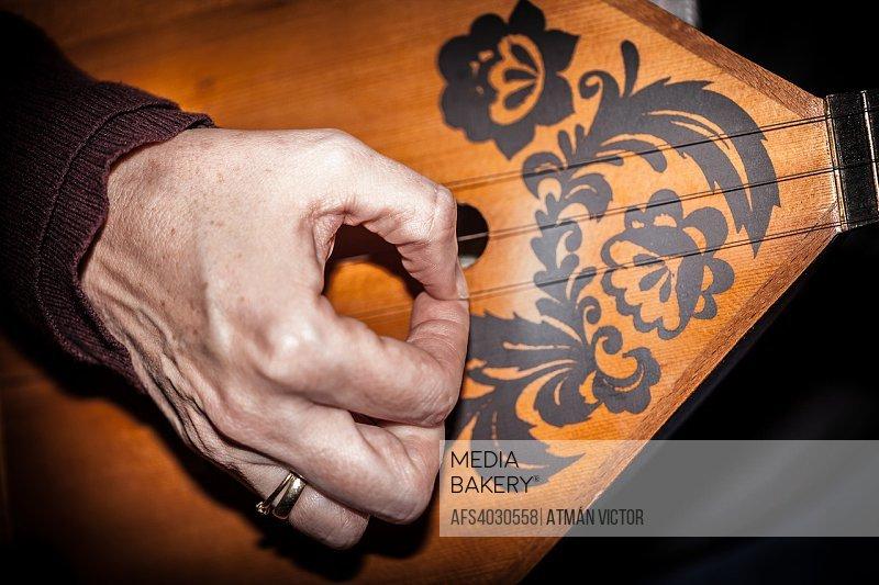 woman playing the balalaika
