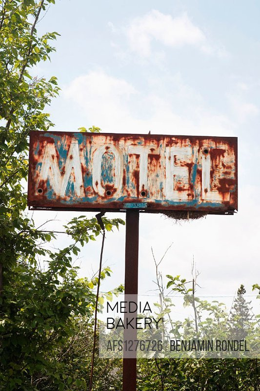 A rusty sign outside an abandoned motel , Ontario, Canada.