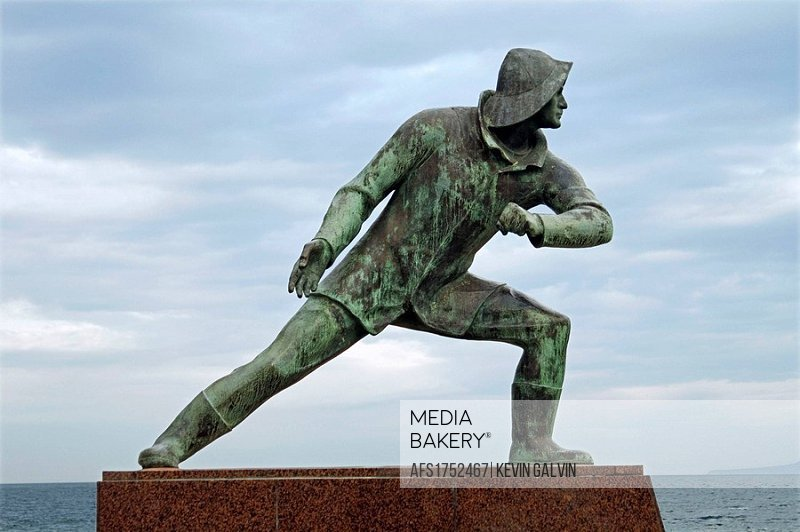 Statue Fishermen Heros WWII on waterfront Milazzo Sicily Italy