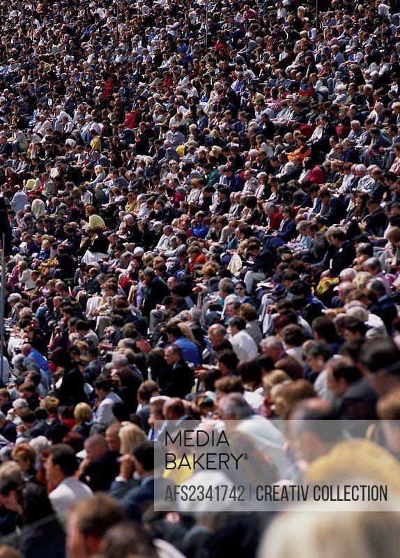 audience sitting on a big platform