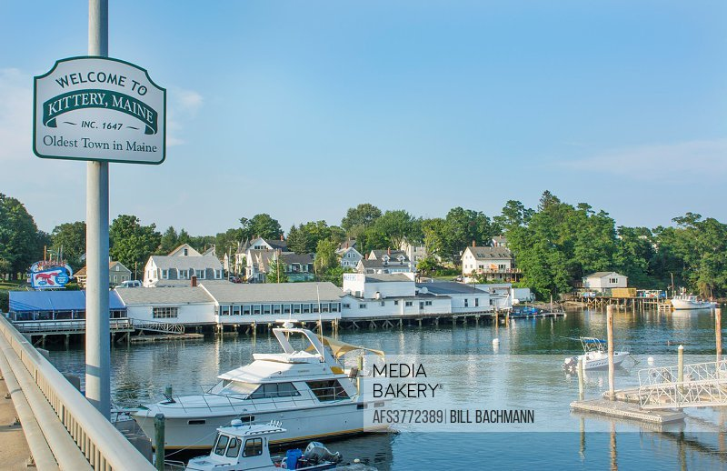 Kittery Maine sign of Welcome and marina with boats on bridge old town settled in 1647 oldest town in Maine.