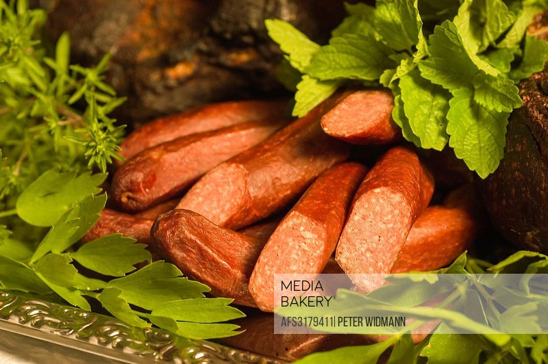 food platter with sausages bacon herbes.
