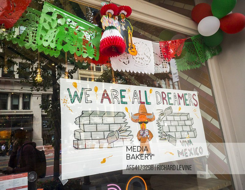 A sign hanging in the window of the Oxido Mexican restaurant in the Chelsea neighborhood of New York on Saturday, September 16, 2017 proclaims we are ...