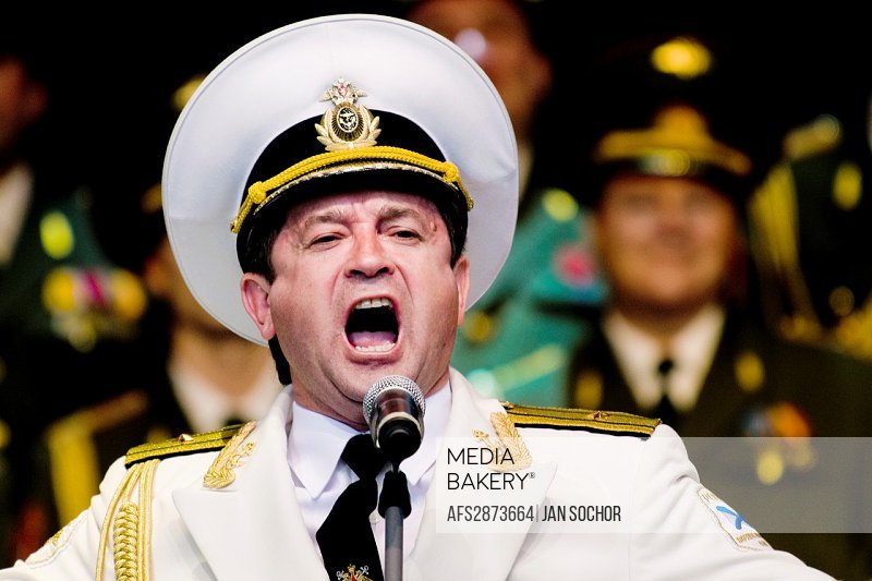 """Vadim Petrovich Anayev, the tenor soloist of the Russian Army Choir """"Alexandrov Ensemble"""", singing solo part in the concert given in a small Czech tow..."""