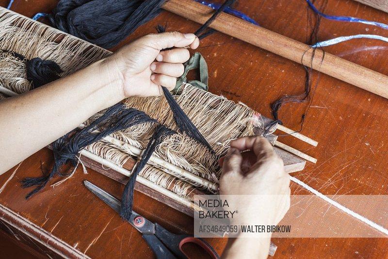 Laos, Vientiane, traditional Lao textile loom.