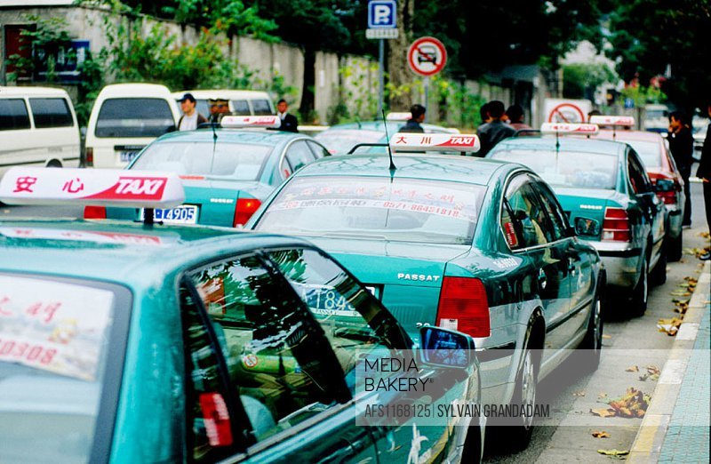 Taxis waiting for customers at the Huge Buddha temple gate. Hangzhou. Zhejiang province, China