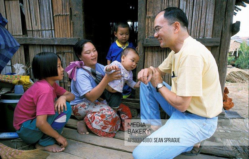 THAILAND. American missionary lay worker at.Lahu tribal village,.Nasiri, near Chiang Mai.