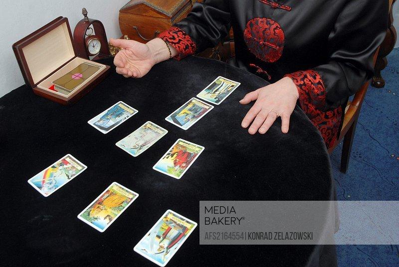 Fortune teller reading the tarot cards