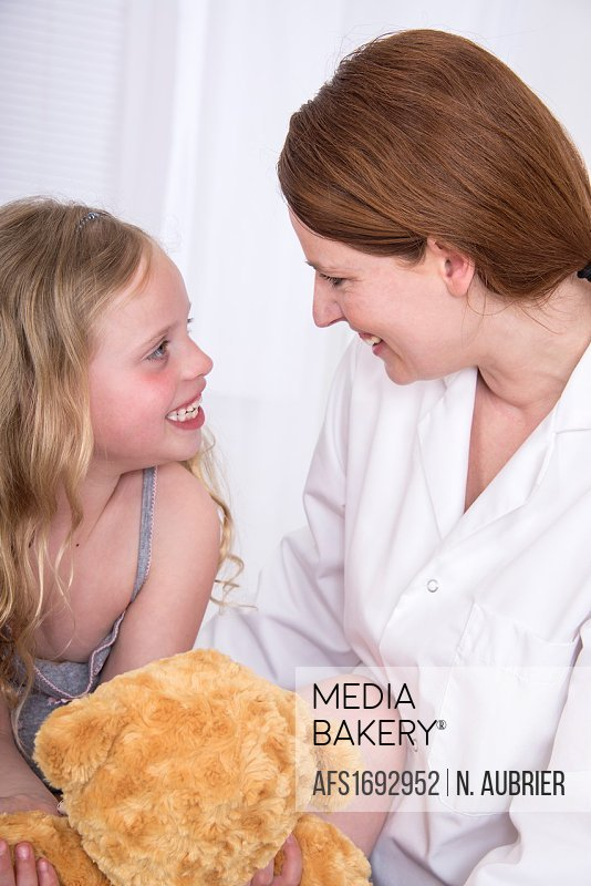 Mediabakery - Photo by Blend Images - Nurse giving woman