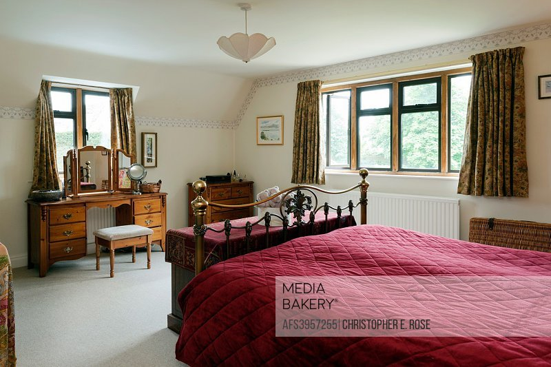 UK homes. A traditionally furnished double aspect bedroom. For Editorial Use Only.