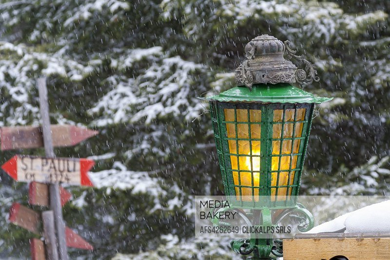 Close-up of street lantern during a snowfall, Baita Monzoni, Val di Fassa, Province of Trento, Trentino Alto-Adige, Italy.