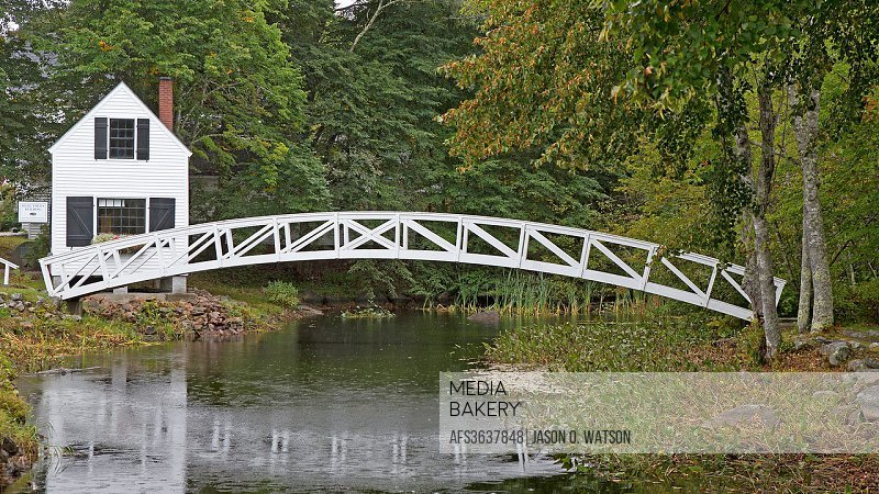 1780 Selectmen´s Building with footbridge over pond, Somesville, Maine, United States of America.