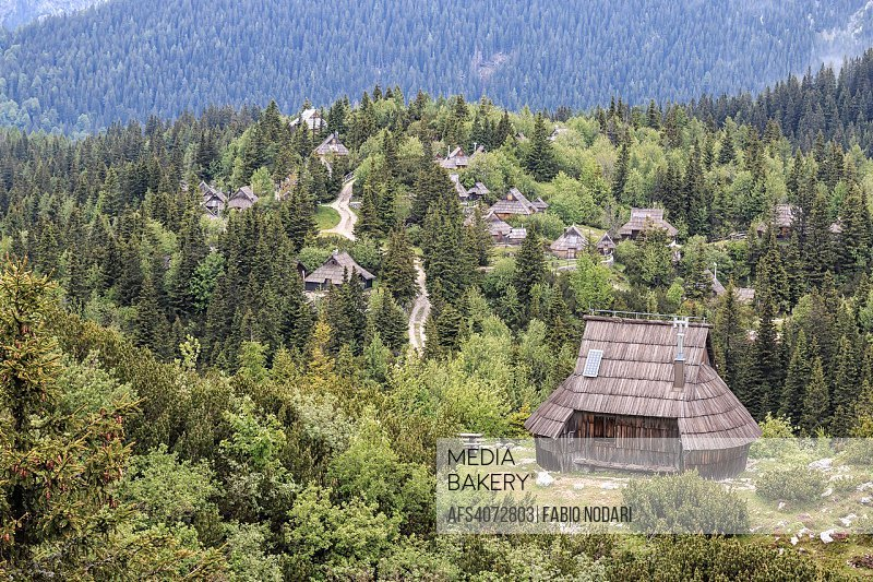 Velika Planina and mountain cottage hut or house.