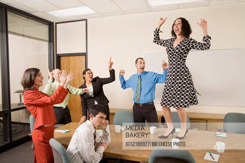Businesspeople acting silly in office