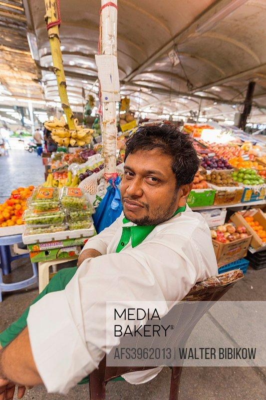 UAE, Dubai, Deira, Dubai Produce Market, produce vendor.