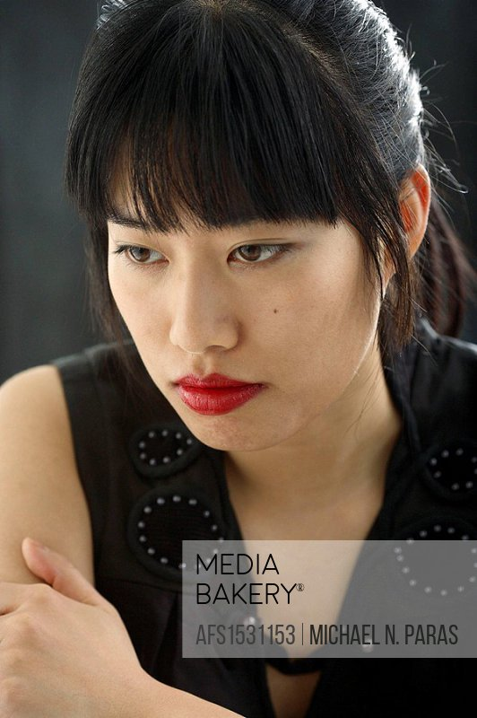 Asian/Chinese woman in serious thought