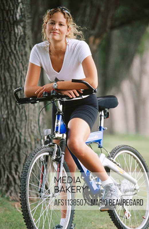 Young woman 20 years old with bike