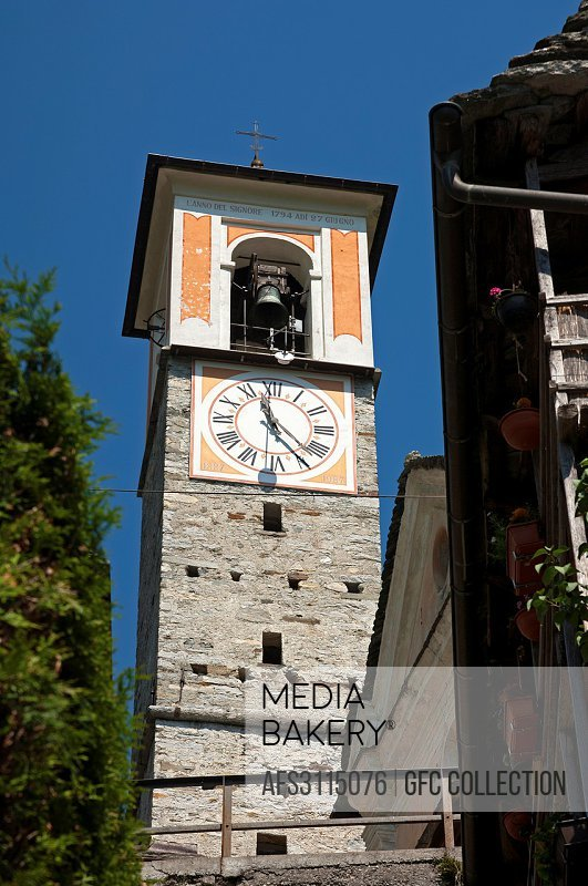 The clock tower of the parish church in the listed village of Corippo, the smallest municipality in Switzerland, Verzasca valley,Ticino, Switzerland.