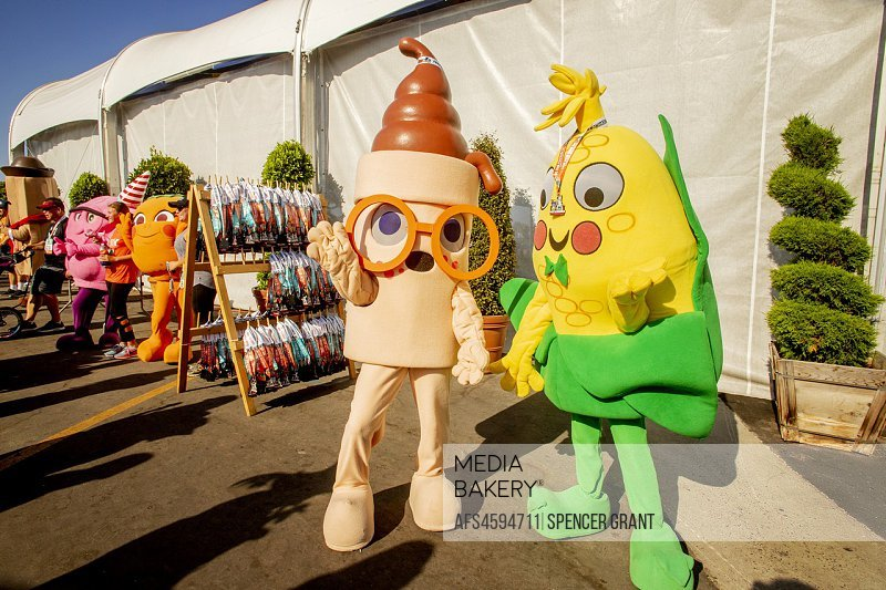 Animated ice cream cones, corn on the cob, candy and an orange greet contestants at a county fair 5K