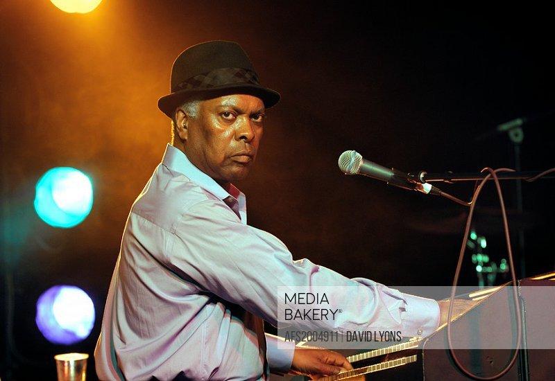 Booker T  Jones, US blues singer musician plays Hammond B3 organ  Main stage marquee  Maryport Blues Festival, 2010  England