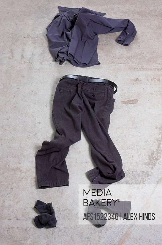 Business clothing abandoned on a concrete floor