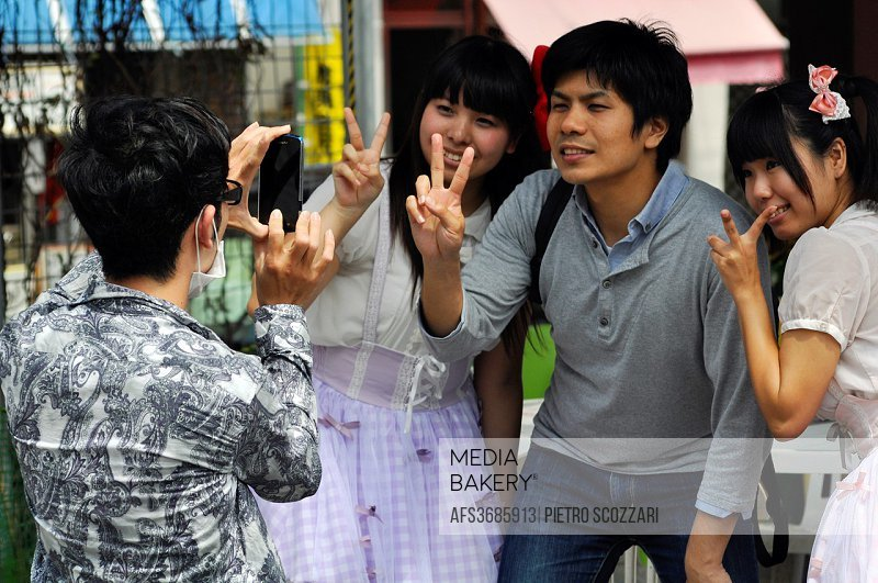 Naha, Okinawa, Japan: friends taking a picture during a cosplay event