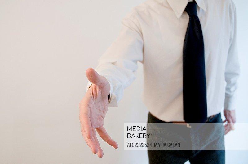 Man extending his open hand, offering handshake